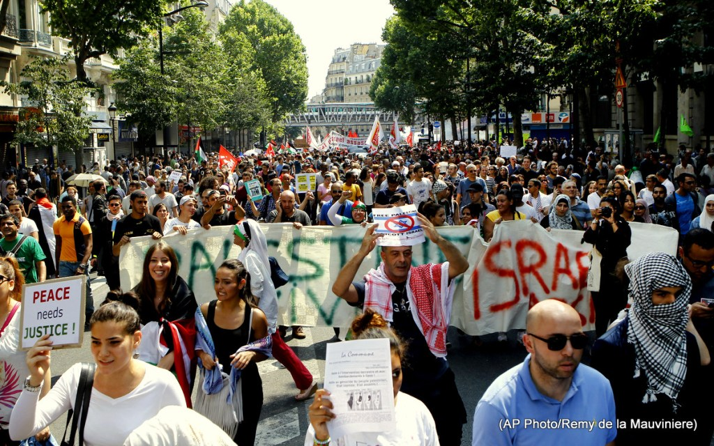 Pro-Palestinian demonstrators holding banners and chanting slogans walk in Paris, Saturday, July 19, 2014, to protest against the Israeli army's shellings in the Gaza strip.