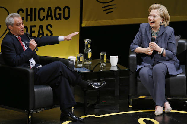 Former U.S. Secretary of State Hillary Clinton shares a laugh with Chicago Mayor Rahm Emanuel during an event in Chicago